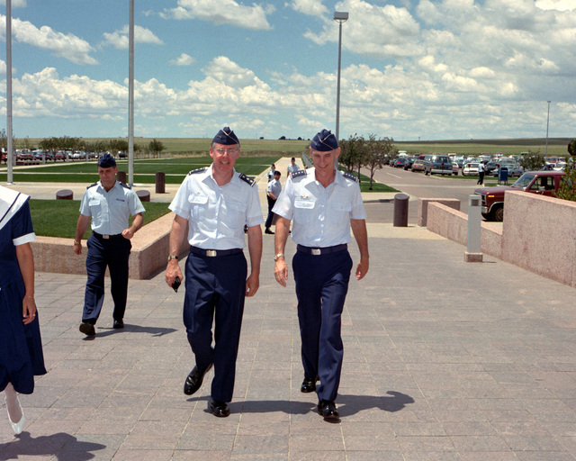 GEN. Merrill A. McPeak, chief of staff of the Air Force, right, is escorted by LT. GEN. Thomas S. Moorman Jr., commander-in-chief, Air Force Space Command, as he arrives for a tour of 2nd Space Wing Facilities