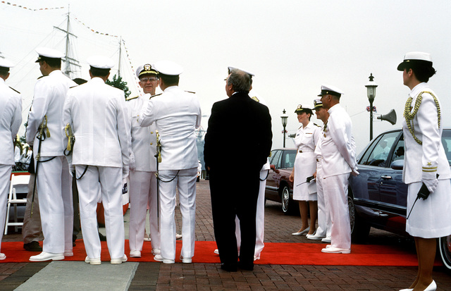 ADM Leon A. Edney, fourth from left, commander in chief, U.S. Atlantic Command, stands with a group of fellow flag officers prior to the start of the commissioning ceremony for the guided missile destroyer USS ARLEIGH BURKE (DDG 51)