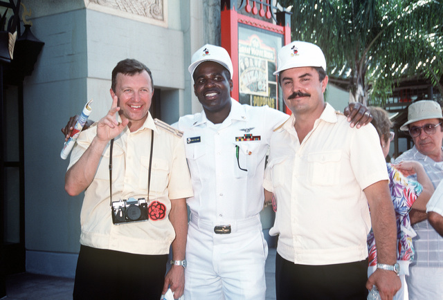 CHIEF Aviation Structural Mechanic Williams is flanked by two Soviet chief petty officers as they pause during their tour of Walt Disney World. Three ships from the Soviet Northern Fleet have come to the United States for a four-day goodwill visit to Naval Station, Mayport, Florida