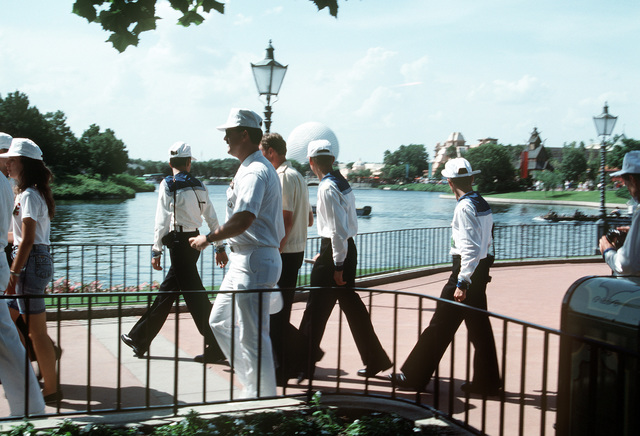 Soviet sailors are accompanied by their U.S. Navy escort as they tour Walt Disney World and Epcot Center. Three ships from the Soviet Northern Fleet have come to the U.S. for a four-day goodwill visit to Naval Station, Mayport, Florida