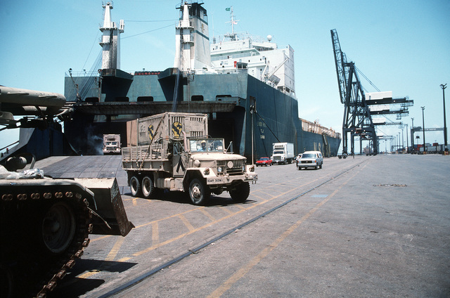 An M-35 2.5-ton cargo truck assigned to the Army's 1ST Cavalry Division is driven off of the end of the stern ramp of the Saudi Arabian roll-on/roll-off cargo ship SAUDI HAIL during unloading operations. The SAUDI HAIL transported vehicles and other equipment back from the Persian Gulf region, where they were used during Operation Desert Shield and Operation Desert Storm