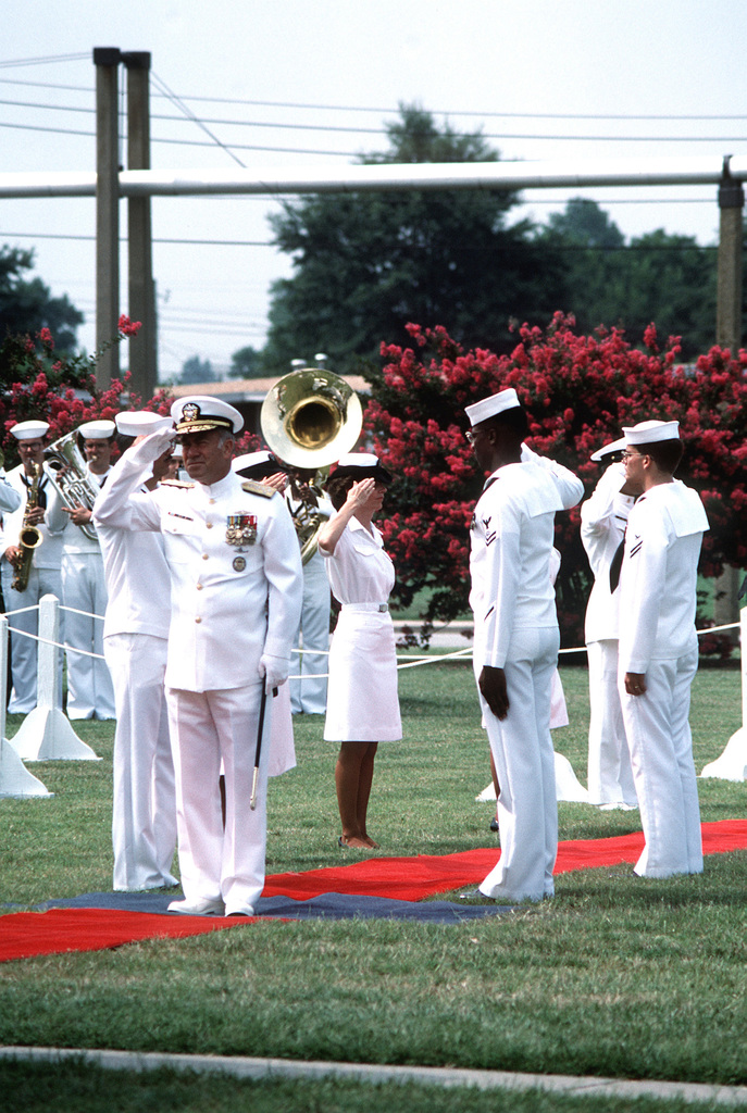 Sideboys salute as ADM Frank B. Kelso II, chief of naval operations, arrives for the Operational Test and Evaluation Force change of command ceremony. RADM Hugh L. Webster will be relinquishing his command of the force to RADM Virgil L. Hill Jr
