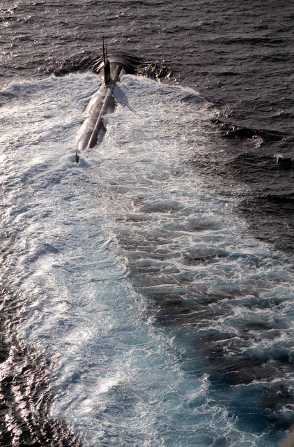A starboard quarter view of the nuclear-powered attack submarine USS ALEXANDRIA (SSN-757) underway during post-commissioning trials off Andos Island, Bahamas. The ALEXANDRIA was commissioned on June 29, 1991.