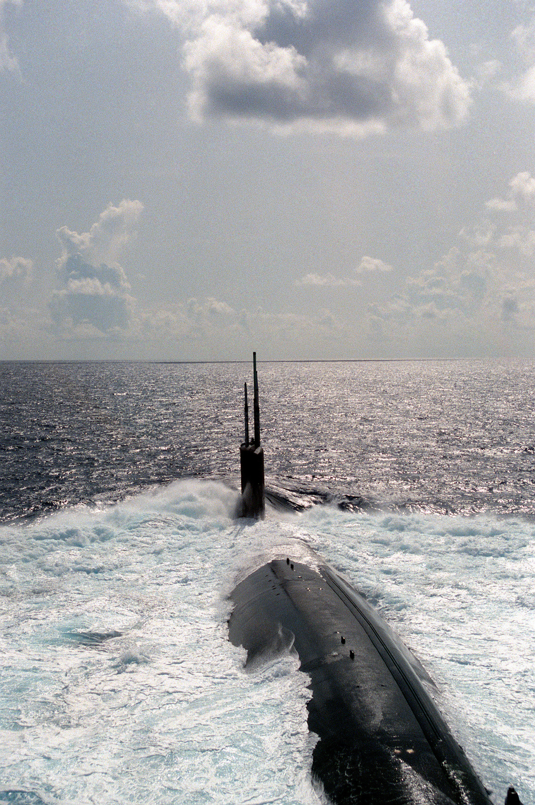 A stern view of the nuclear-powered attack submarine USS ALEXANDRIA (SSN-757) underway during post-commissioning trials off Andros Island, Bahamas. The ALEXANDRIA was commissioned on June 29, 1991.