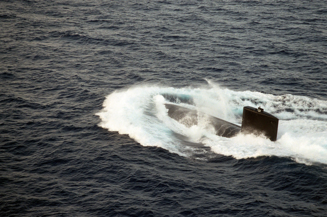 The nuclear-powered attack submarine USS ALEXANDRIA (SSN-757) surfaces during post-commissioning trials off Andros Island, Bahamas. The ALEXANDRIA was commissioned on June 29, 1991.