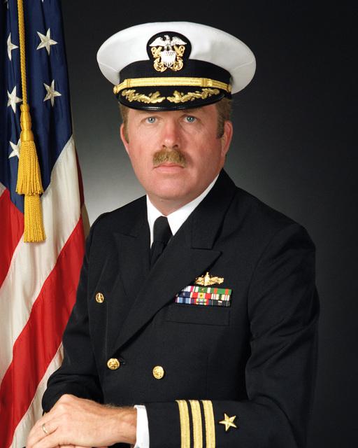 Commander Joseph B. Wilkinson, USN (covered)