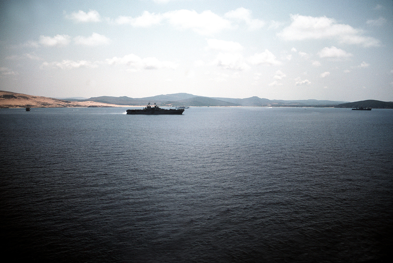 The amphibious transport dock USS PONCE (LPD 15), left; the amphibious assault ship USS WASP (LHD 1), center foreground; the tank landing ship USS SUMTER COUNTY (LST 1181), center background; and the amphibious cargo ship USS EL PASO (LKA 117) lie off the coast of Tunisia during an amphibious exercise