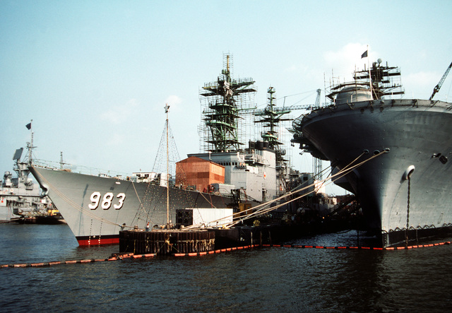 The destroyer USS JOHN RODGERS (DD 982), left, and the amphibious assault ship USS IWO JIMA (LPH 2) lie tied up at the Metro Machine Company's Imperial Docks for overhaul work