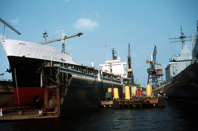 The Military Sealift Command transport oiler USNS SEALIFT INDIAN OCEAN (T-AOT 171) sits in the dry dock Virginian at the Norfolk Shipbuilding and Drydock Corp. while undergoing overhaul work