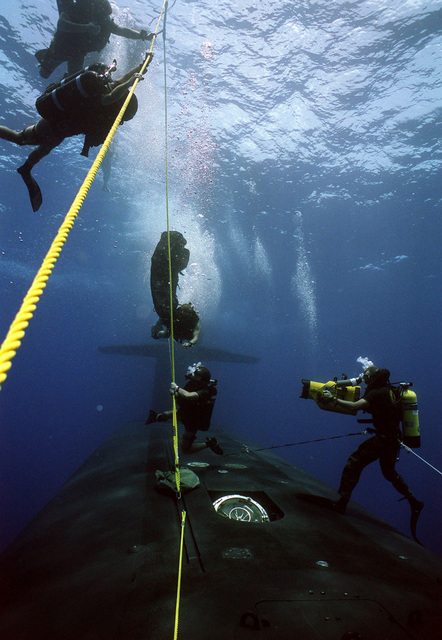 A photographer's mate/diver films activities as members of a Navy sea-air-land (SEAL) team descend toward the submerged nuclear-powered strategic missile submarine USS WOODROW WILSON (SSBN 624). The SEAL team is taking part in lock-out procedures off the coast of Puerto Rico.