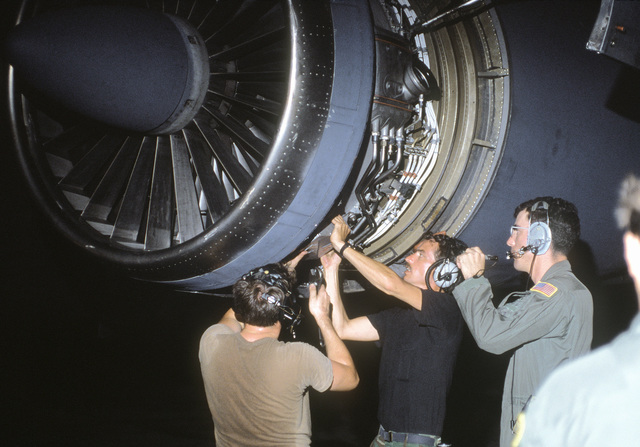 Maintenance personnel work on an engine of a Military Airlift Command C-141B Starlifter aircraft during a stopover en route to Kinshasa, Zaire. The aircraft is transporting Belgian troops and equipment to Zaire as part of an effort to evacuate French and Belgian citizens from the country during a period of political upheaval.