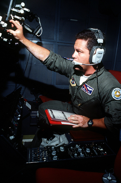 SENIOR AIRMAN Abel Saenz checks the operation of the refueling boom of a 6th Air Refueling Squadron, 22nd Air Refueling Wing, KC-10A Extender aircraft while flying over the California coastline