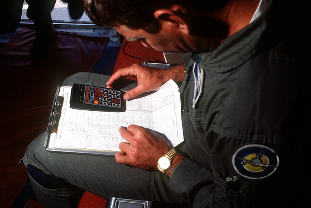 SENIOR MASTER SGT. Ted Whorley calculates the weight load plan for a 6th Air Refueling Squadron, 22nd Air Refueling Squadron, 22nd Air Refueling Wing, KC-10A Extender aircraft during a Military Airlift Command channel cargo mission. Whorley is the Strategic Air Command's program manager for Extender aircraft refuelikng boom operators