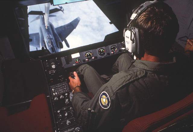 SENIOR MASTER SGT. Ted Whorley operates the boom of a 6th Air Refueling Squadron, 22nd Air Refueling Wing, KC-10A Extender aircraft while refueling a 163rd Tactical Fighter Wing RF-4C Phantom aircraft during the Strategic Air Command Exercise Proud Visitor. Whorley is the Strategic Air Command's program manager for extender boom operators