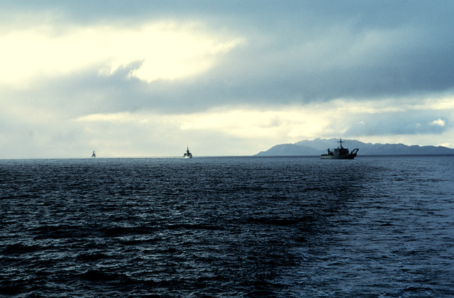 U.S. and Chilean vessels proceed along the Strait of Magellan during Unitas XXXII, a combined exercise involving the naval forces of the United States and nine South American nations