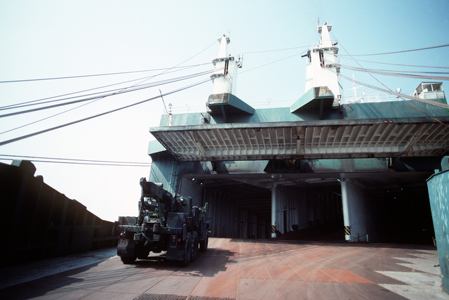 An M-816 5-ton wrecker is driven onto the Saudi Arabian roll-on/roll-off cargo ship SAUDI HAIL during loading operations at Blount Island Terminal. Helicopters and support equipment of the 101st Airborne Division (Air Assault) are being loaded aboard the SAUDI HAIL for transport to the Persian Gulf region for Operation Desert Shield