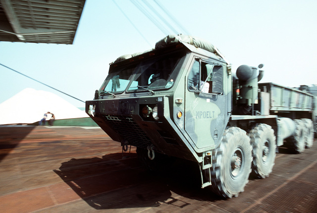 An M-997 heavy expanded mobility tactical truck (HEMTT) is driven onto the Saudi Arabian roll-on/roll-off cargo ship SAUDI HAIL during loading operations at Blount Island Terminal. Helicopters and support equipment of the 101st Airborne Division (Air Assault) are being loaded aboard the SAUDI HAIL for transport to the Persian Gulf region for Operation Desert Shield