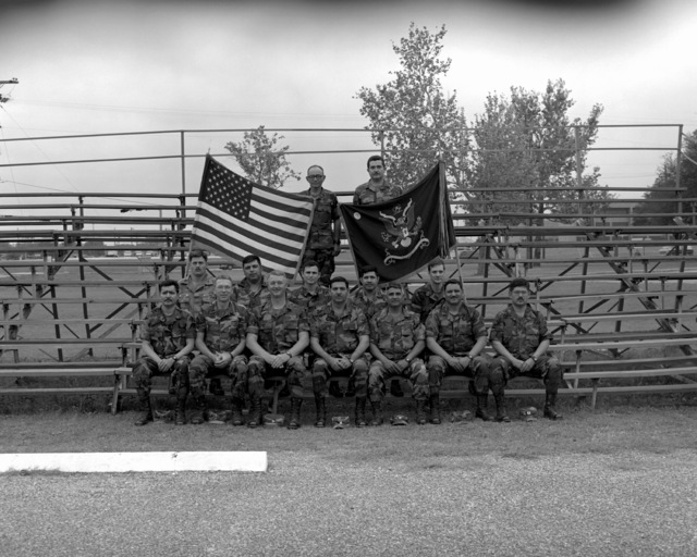 A group portrait of the battalion staff of the 3rd Battalion, 141st Infantry, a reserve unit that was called to active duty during Operation Desert Shield. Seated, from left, are: CAPT E. Martinez, CAPT B. Schorp, Chaplain (LT COL) R. Anderson, CAPT F. E. Curiel, MAJ. M. Buck, 1ST LT A. Ramirez, MAJ. J. Campos (commanding officer), CAPT R. Alonzo, MAJ. A. Esqueda, 2nd LT K.R. Broome, CAPT J.D. Martinez and CAPT A.R. Garza. Standing are Command SGT. MAJ. S. Tamez, left, and 1ST LT A Barrera