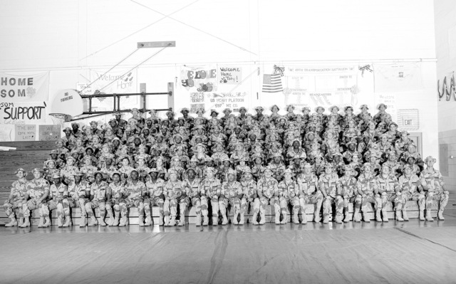 A group portrait of the soldiers of the 279th Maintenance Company prior to the unit's demobilization. The company is a reserve unit that was called to active duty during Operation DESERT SHIELD