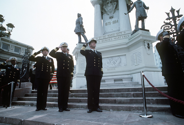 RADM Theodore C. Lockhart, commander, South Atlantic Force, is flanked by two senior Chilean naval officers as he salutes during a wreath-laying ceremony at a monument honoring the Chilean servicemen who died during their country's 1879-1884 war with Bolivia. Lockhart is in Valparaiso as commander of the United States units taking part multinational naval exercise Unitas XXXII