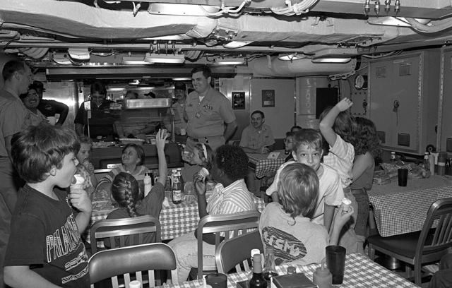 CAPT Donald G. McDermott, commanding officer, gold crew, prepares to answer questions from fourth and fifth grade students as they enjoy an ice cream break aboard the nuclear-powered strategic missile submarine USS WEST VIRGINIA (SSBN 734). The children are honor roll students at Matilda Harris Elementary School and are being treated to an hour-long tour of the vessel