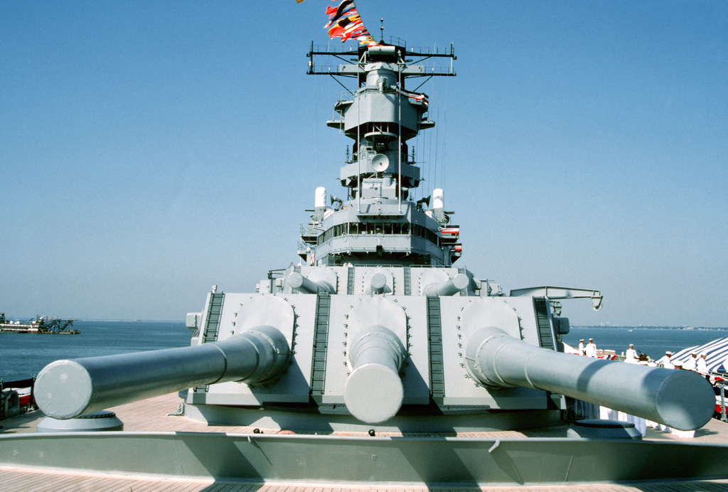 A view of two of the Mark 7 16-inch/50-caliber gun turrets and the superstructure aboard the battleship USS WISCONSIN (BB-64) during the ship's decommissioning ceremony. The ceremony marks the end of the WISCONSIN's third period in commission, which began on October 22, 1988