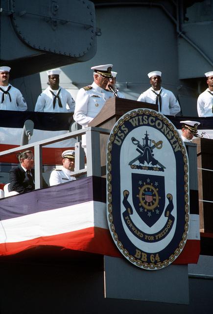 CAPT Conrad van der Schroeff, commanding officer of the battleship USS WISCONSIN (BB-64), speaks during the vessel's decommissioning ceremony