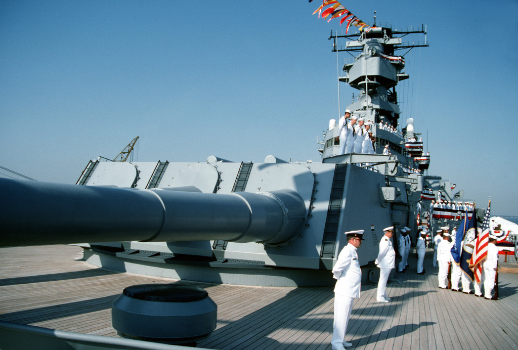Crewmen stand at parade rest on one of the Mark 7 16-inch/50-caliber gun turrets aboard the battleship USS WISCONSIN (BB-64) during the ship's decommissioning ceremony. The ceremony marks the end of the WISCONSIN's third period in commission, which began on October 22, 1988