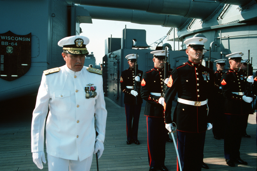 Members of the ship's Marine detachment stand at present arms as ADM Paul D. Miller, commander in chief, U.S. Atlantic Fleet, walks past them during the decommissioning ceremony for the battleship USS WISCONSIN (BB-64). The ceremony marks the end of the WISCONSIN's third period in commission, which began on October 22, 1988