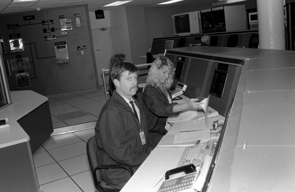 Computer technicians man terminals in the Electronic Data Center of the Naval Computer and Telecommunications Station