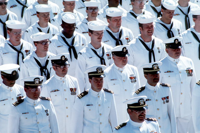 LCDR Louis Meier, lower left, executive officer of the guided missile destroyers USS LYNDE MCCORMICK (DDG-8), stands in front of the ship's officers and enlisted men during the ship's decommissioning. Three guided missile destroyers, the LYNDE MCCORMICK, the USS BUCHANAN (DDG-14) and the USS ROBISON (DDG-12), are being decommissioned in a combined ceremony