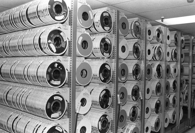 Magnetic tape reels containing 30 million characters a piece line shelves in the Electronic Data Center of the Naval Computer and Telecommunications Station