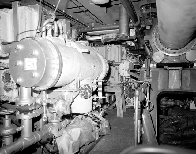 Auxiliary machinery room No. 1, compartment 5-220-O-E, aboard the guided missile cruiser USS LAKE ERIE (CG 70). The LAKE ERIE, under construction at the Bath Iron Works Corp. shipyard, is 70 percent complete