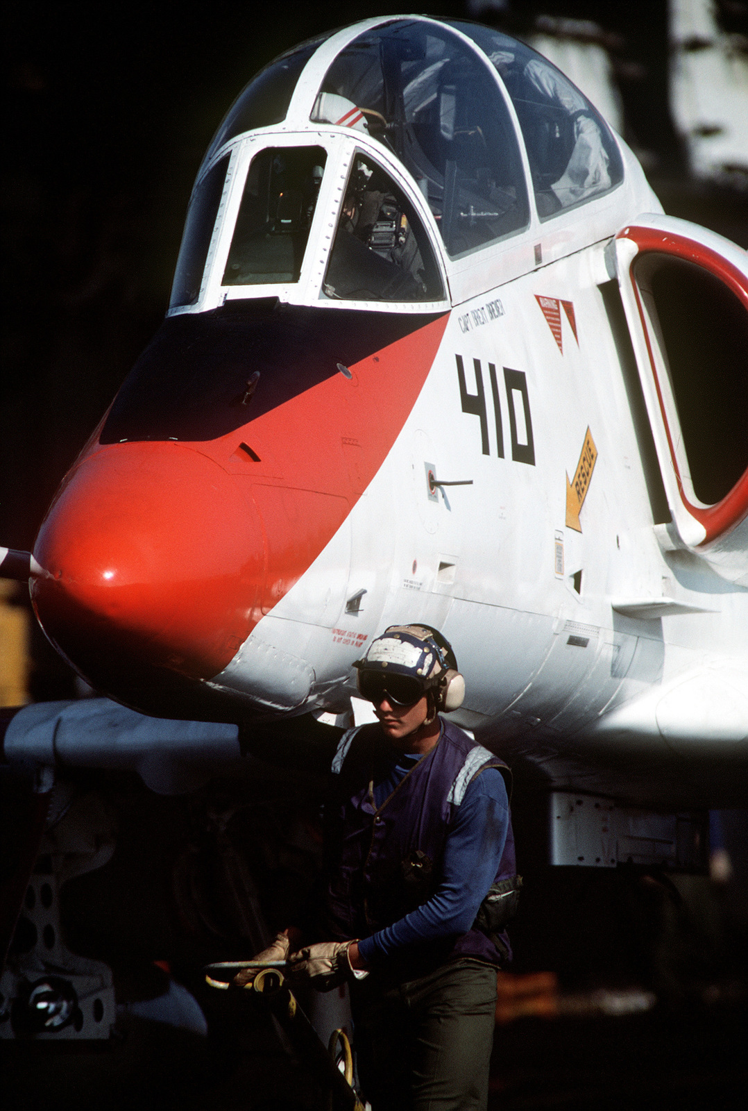 An aircraft handler uses a tiller bar to steer a TA-4J Skyhawk aircraft toward one of the catapults on the flight deck of the aircraft carrier USS FORRESTAL (CV 59). The FORRESTAL will assume the role of the Navy's training carrier in early 1992, taking over for the auxiliary aircraft landing training ship USS LEXINGTON (AVT 16)
