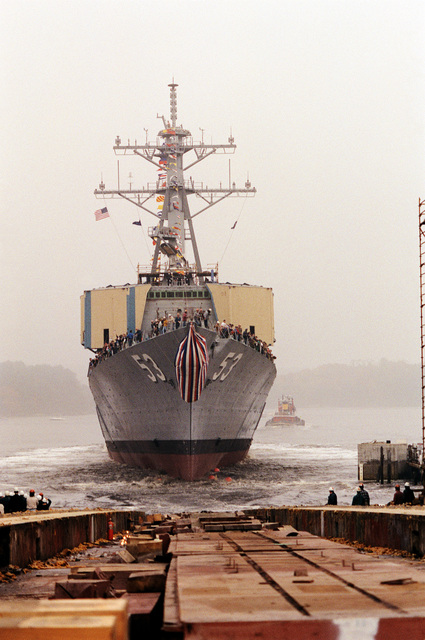 The guided missile destroyer JOHN PAUL JONES (DDG-53) enters the water after being launched from the ways at Bath Iron Works Shipyard. The vessel has just been christened, with Connie Jeremiah acting as ship's sponsor. Mrs. Jeremiah is the wife of ADM David E. Jeremiah, vice chairman, Joint Chiefs of STAFF.
