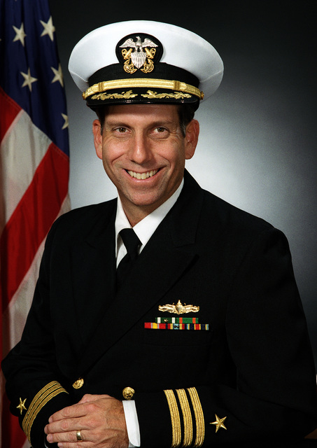 Commander John M. MacIntyre, USN (covered)