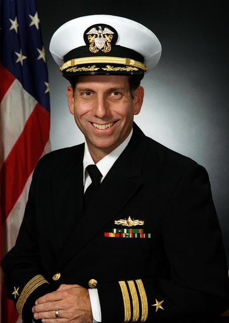Commander John M. MacIntyre, USN (covered)