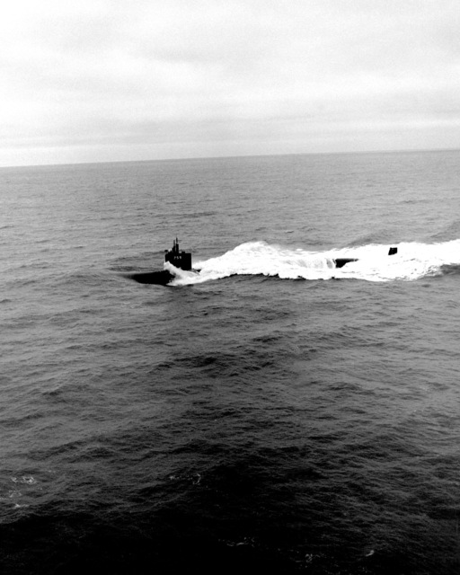 A port beam view of the nuclear-powered attack submarine JEFFERSON CITY (SSN-759) underway during sea trials off the Virginia Capes