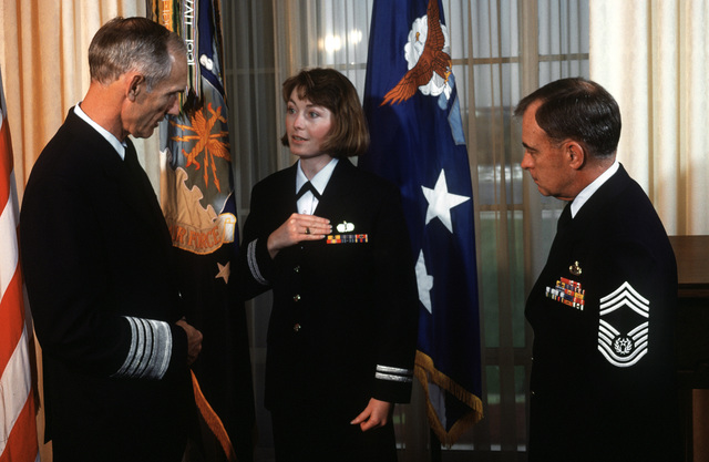 The new look for Air Force uniforms is modeled by, (left to right): GEN. Merrill A. McPeak, chief of staff; CAPT. Cathy McGinn, Air Force clothing branch chief; and CHIEF MASTER SGT. of the Air Force Gary Pfingston