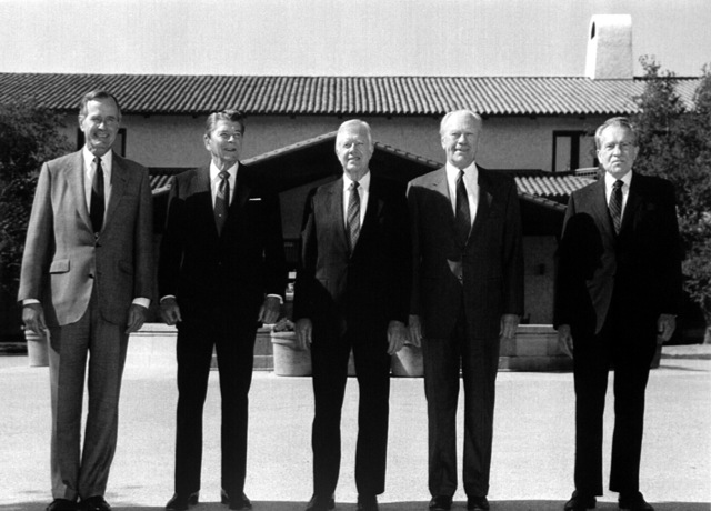 President George H. W. Bush poses for a photograph with four of his predecessors at the opening of the Ronald Reagan Presidential Library. The dignitaries include, from left: President Bush and former presidents Ronald Reagan, Jimmy Carter, Gerald Ford and Richard Nixon