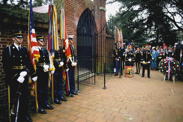 "A US Military Joint Service Color Guard waits with Members of the US Army (USA) Band ""Pershing's Own,"" for the beginning of a Wreath-Laying Ceremony held at Mount Vernon, Virginia (VA)"