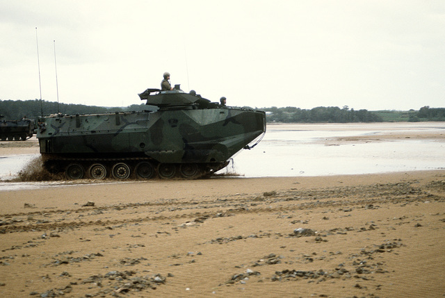 Marine Corps Base, Camp Smedley D. Butler. An AAV-7A1 amphibious assault vehicle of the 1ST Armored Assault Battalion (AABN), 3rd Marine Division, moves across the beach after coming ashore during a combat training exercise at the Central Training Area (CTA)