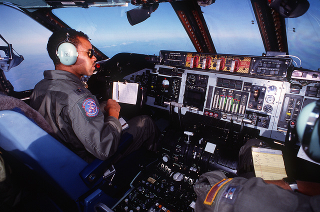 CAPT. Gregory Gibbs, 86th Airlift Squadron, monitors controls in the cockpit of a C-141B Starlifter aircraft en route to Incirlik Air Base, Turkey. The aircraft will later proceed to Damascus, Syrial, to pick up freed hostage Joseph Cicippio, released after being held captive in Lebanon by Shiite Moslem kidnappers for over five years.