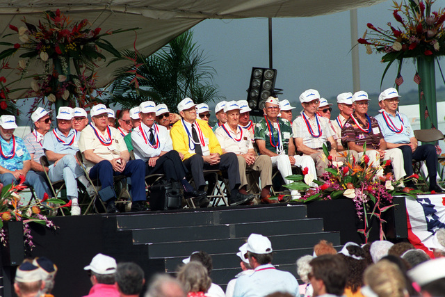 Crew members of the USS ARIZONA who survived the Dec. 7, 1941, attack on Pearl Harbor sit on stage during Remembrance Day ceremonies at the USS ARIZONA Memorial Visitors Center. The survivors are honored on the 50th anniversary of the Japanese bombing