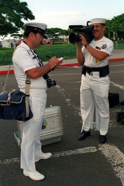 Members of Fleet Imaging Command Pacific check their equipment before covering Remembrance Day ceremonies commemorating the 50th anniversary of the Dec. 7, 1941, attack on Pearl Harbor