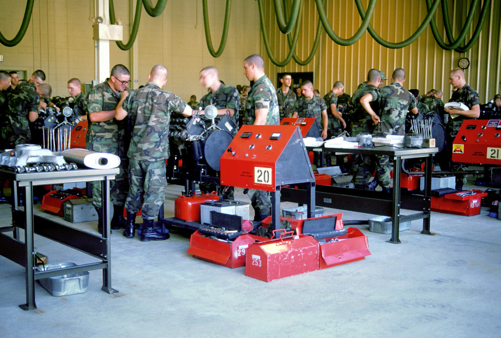 Students in the heavy wheeled vehicle mechanic course learn to disassemble and assemble engines during advanced individual training