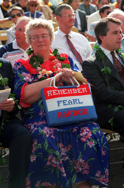 Jean Glaubitz, wife of Gerald A. Glaubitz, Mayor of Morningside, Maryland, holds a needlework memento of remembrance during Survivor's Day ceremonies at the USS ARIZONA Memorial Visitors Center. The event honors the sailors and Marines of the battleships that were sunk or damaged in the Dec. 7, 1941, attack on Pearl Harbor