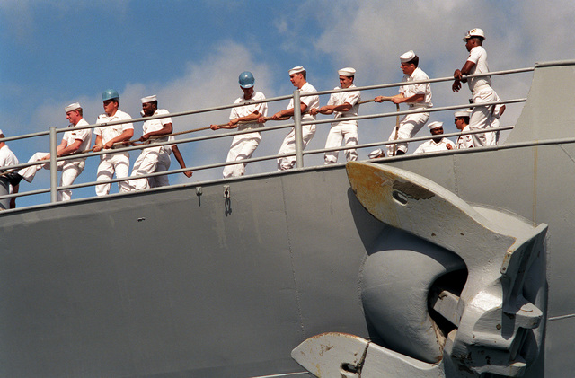 The deck crew of the USS MISSOURI (BB-63) handles the mooring lines as the battleship arrives in port on Survivor's Day, when the sailors and Marines of the battleships that were sunk or damaged in the Dec. 7, 1941, attack on Pearl Harbor are honored. The battleship, the last of its kind in commission, is deployed to help commemorate the 50th anniversary of the bombing
