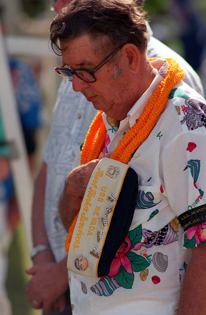 A former crew member of the battleship USS NEVADA (BB-36) bows his head during the dedication of the USS NEVADA MEMORIAL at Hospital Point, one of the events taking place during observances marking the 50th anniversary of the Japanese attack on Pearl Harbor