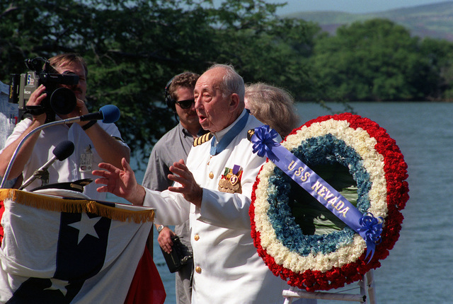 CAPT Donald K. Ross, USN (Ret.), a survivor of the Japanese attack on Pearl Harbor and a Medal of Honor recipient, leads the audience in a rendition of God Bless America during the dedication of the USS NEVADA MEMORIAL at Hospital Point. The dedication is taking place as part of an observance commemorating the 50th anniversary of the Japanese attack